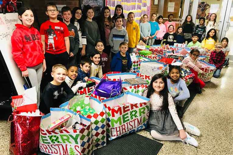 Race Brook School's Families Generously Donate Gifts to Less Fortunate Children