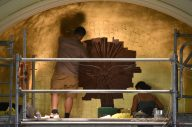 Gilding the space around the Holy Spirit in the apse.