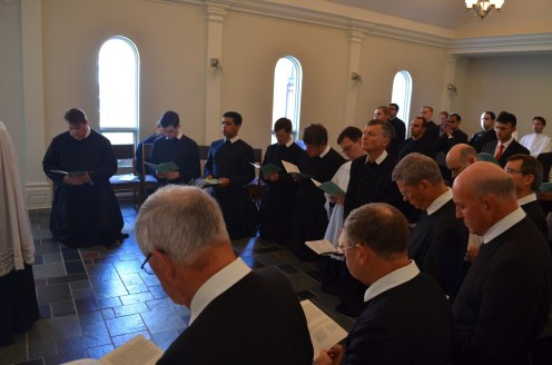 The Oratorians and guests pray the litany during the clothing