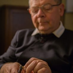 An Oratorian crafts a rosary.