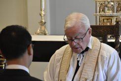 Fr Robinson leads the prayers
