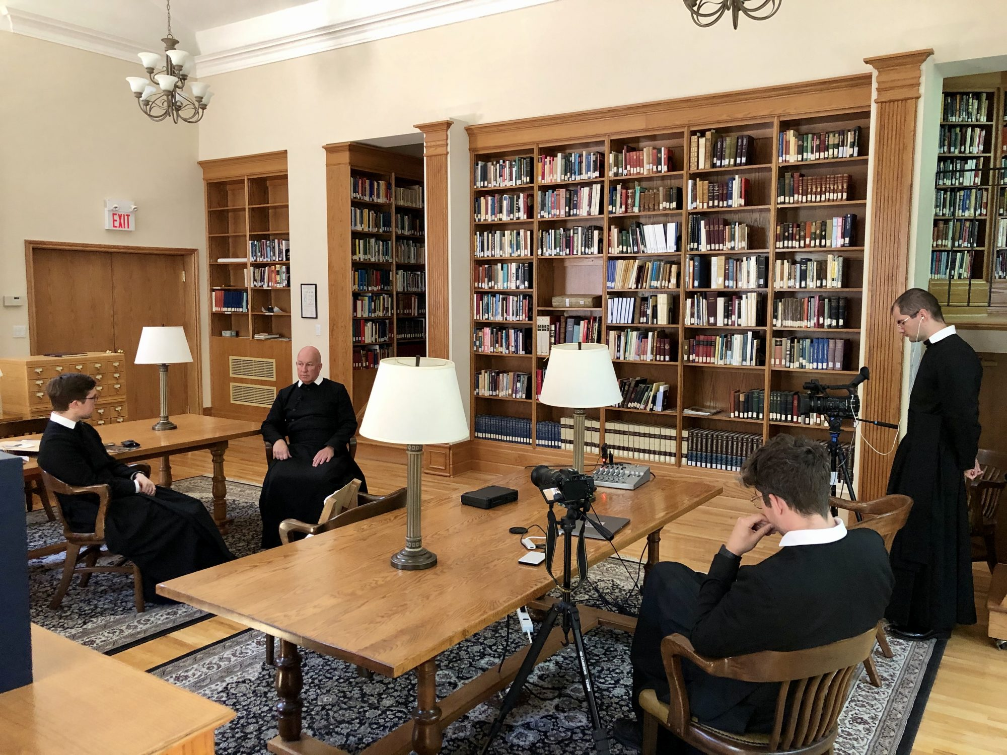 Br Carter and Br Bruno film Fr Michael interviewing Fr Juvenal in the library.