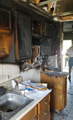 Fire damaged kitchen.