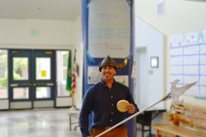 Phil Comito wearing a viking helmet and holding The Spear of Spirit