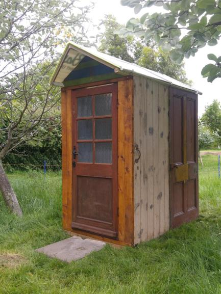 The yurt toilet made out of reclaimed doors