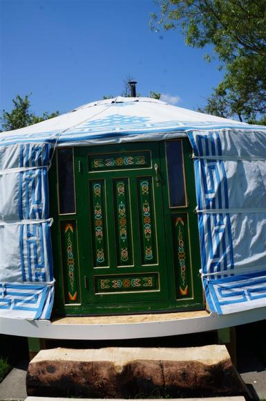 The yurt door, handpainted in a Mongolian design