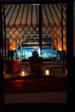Cosy inside Burbank Yurt at nighttime