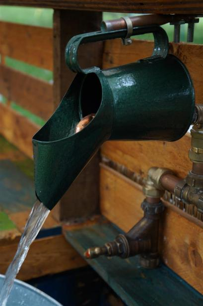 The Burbank Yurt has a kitchen area made from reclaimed materials, including this oil can tap