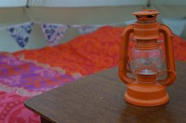 Each bell tent comes with a cosy and colourful furnished interior.