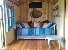 The day bed in Avalon has a trundle underneath it so the carriage allows 4 people to sleep in comfort.