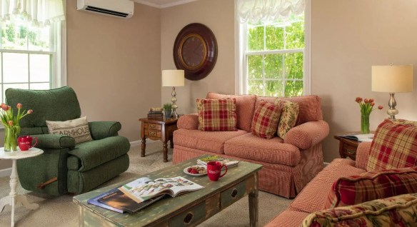 Inviting living room space with comfy couches and large windows.