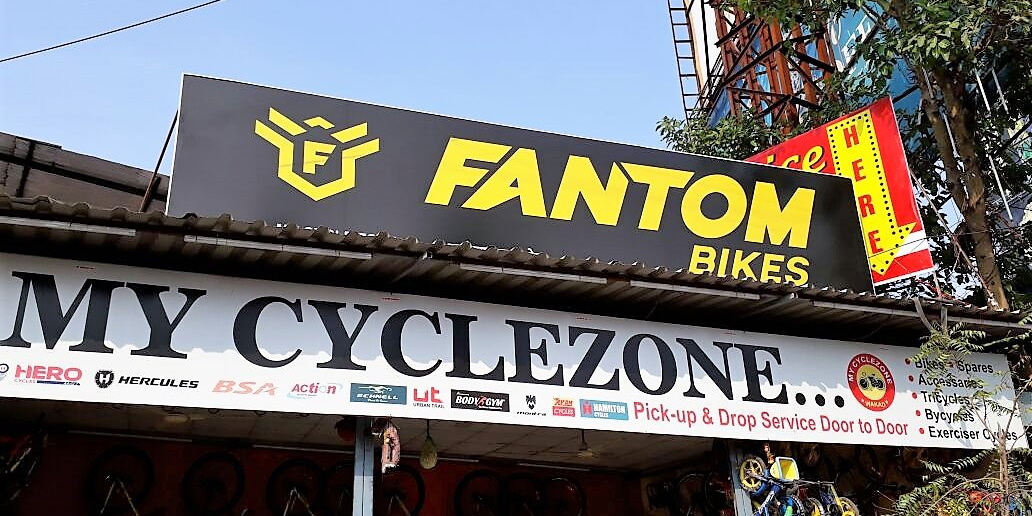fabricated backlit sign board for the Fantom cycle shop with lights innstalled within
