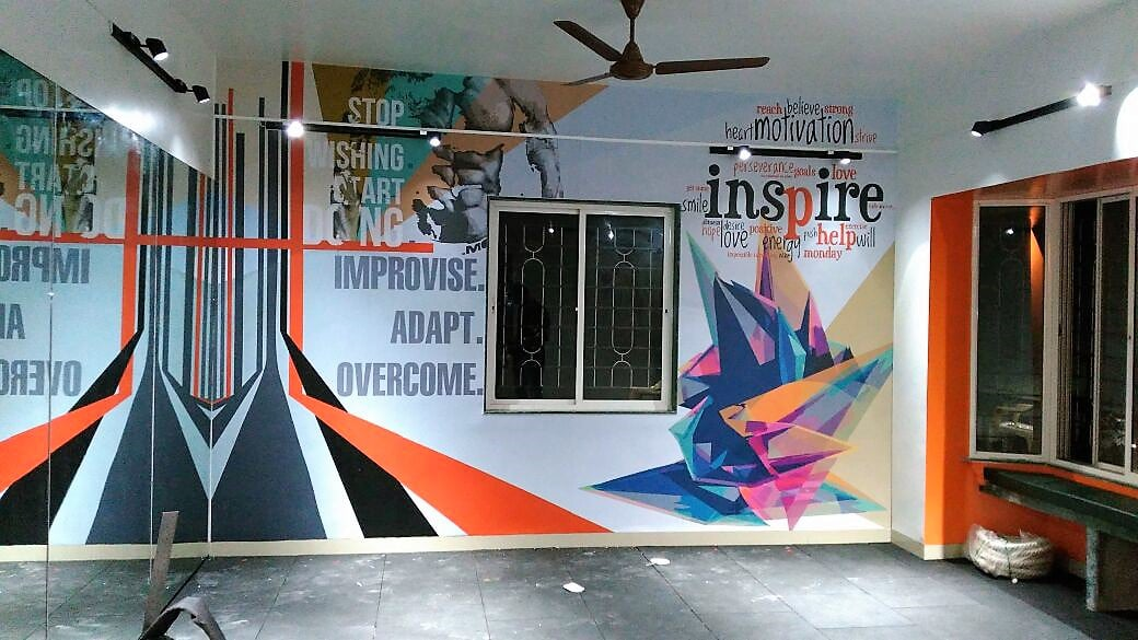 A full wall sized sticker pasted on the wall of a gymnasium to enhance its looks. The print is installed around a window in the center of the wall