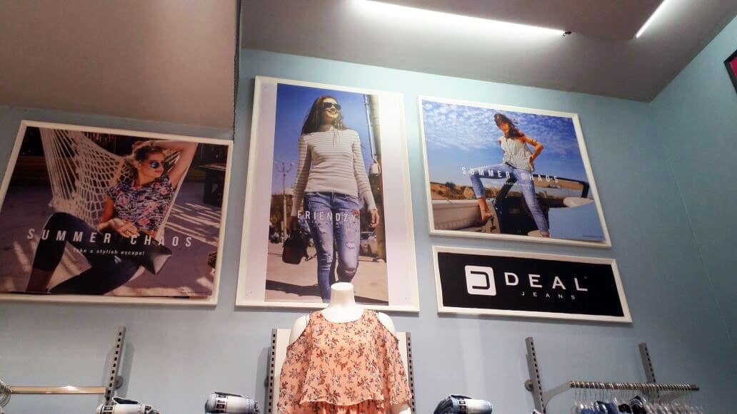 store branding done for a clothing company in a mall using photo prints on sun board