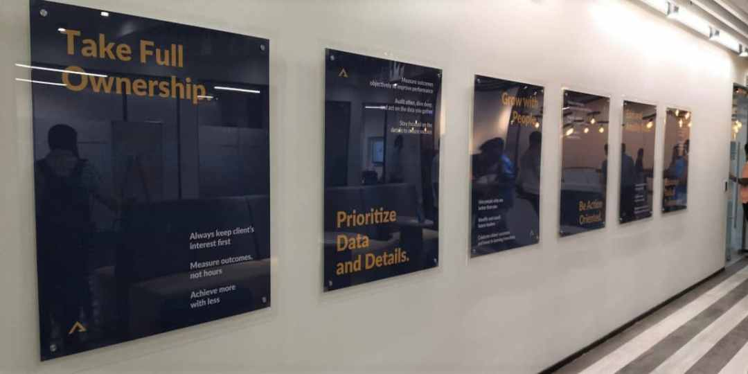 picture of acrylic sandwich boards installed in line at a software company. the images within can be replaced by removing the top sheet of acrylic