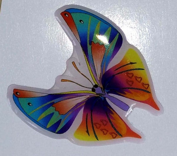 Domed label cut in the shape of a butterfly and given a gel coating