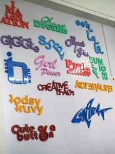 Words and phrases artistically cut on a CNC router to create 3D wall graffiti as an interior design idea for kids room