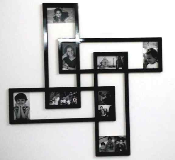 Funky shaped photo frame holding multiple photographs