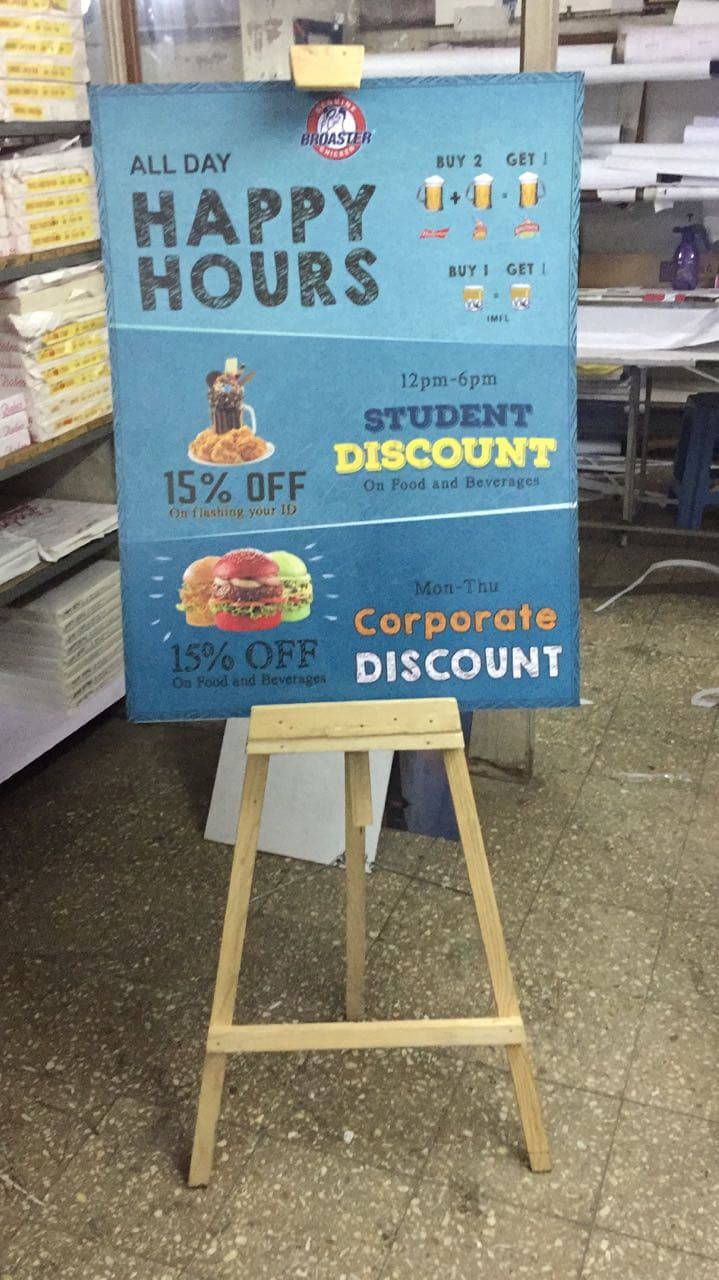 wooden easel standee to garner customer attention