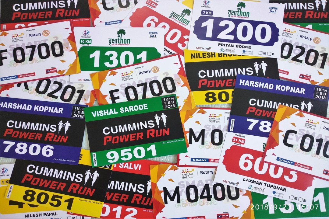 marathon bibs on non tear able paper containing runners name number and other data