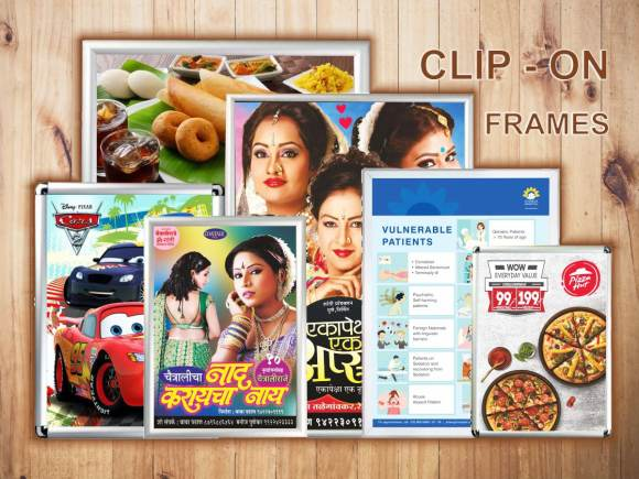 a collection of aluminium clip on boards which display posters in a refined and elegant manner