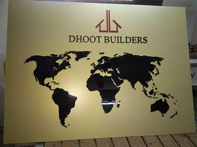 This image shows an acrylic shop board for the Pune-based construction company, Dhoot Builders.