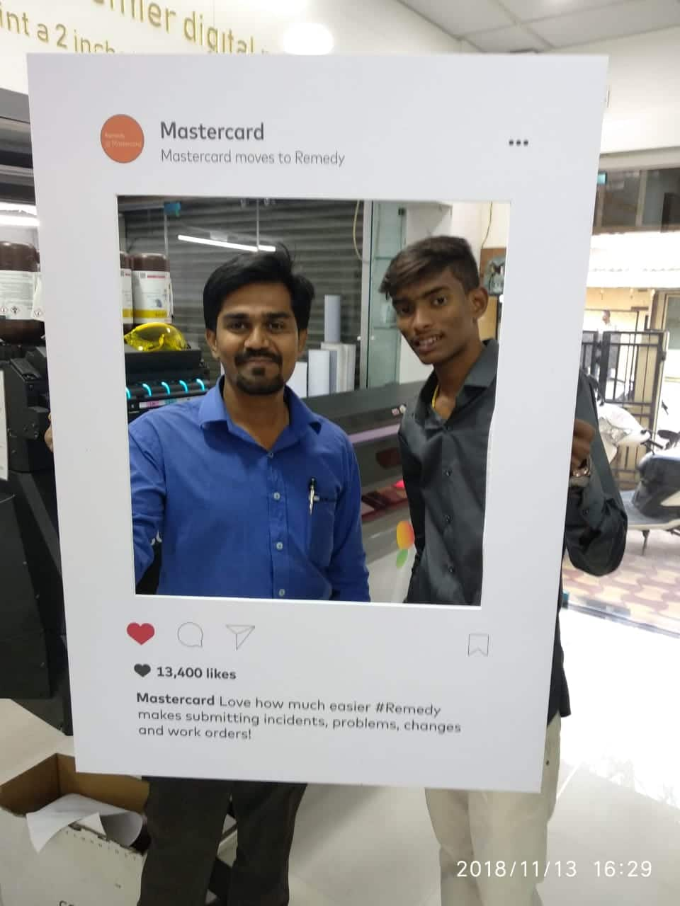 instagram frame made out of sunboard having the center portion cut out and hand holds behind