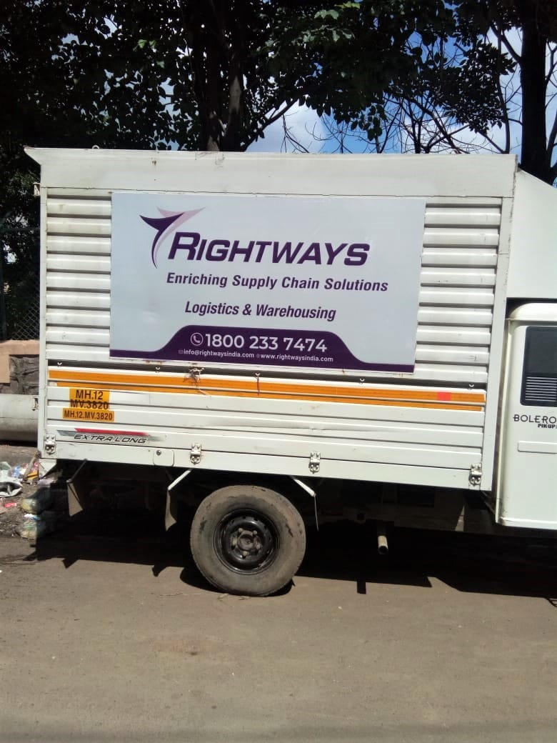 Rightways Co vehicle branding using UV printed reflective vinyl on ACP sheet bolted to the side of Tata Ace chota hathi