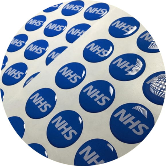 blue circular domed stickers having a raised effect make for premium quality logo stickers