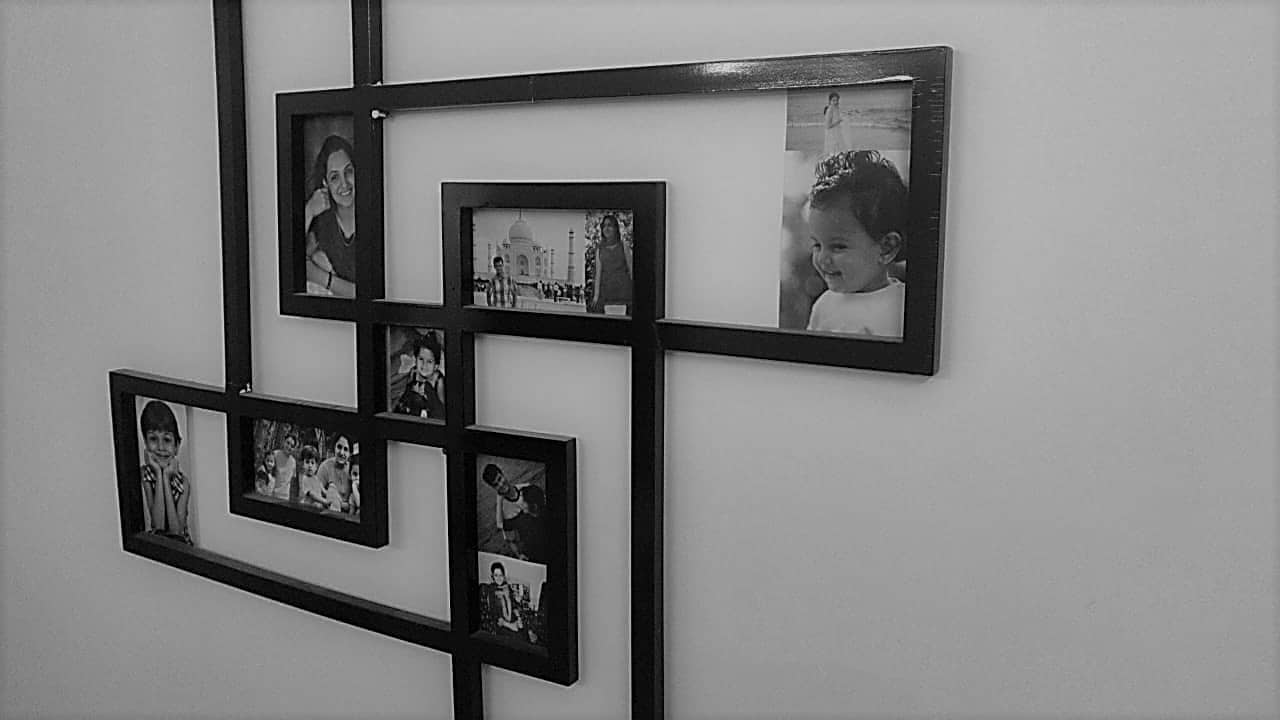photo collage in a frame uniquely shaped in the shape of a photo