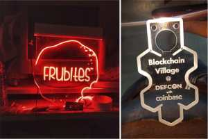 two acrylic panels laser engraved with company logos and side lit with LEDs to make the letters glow brightly