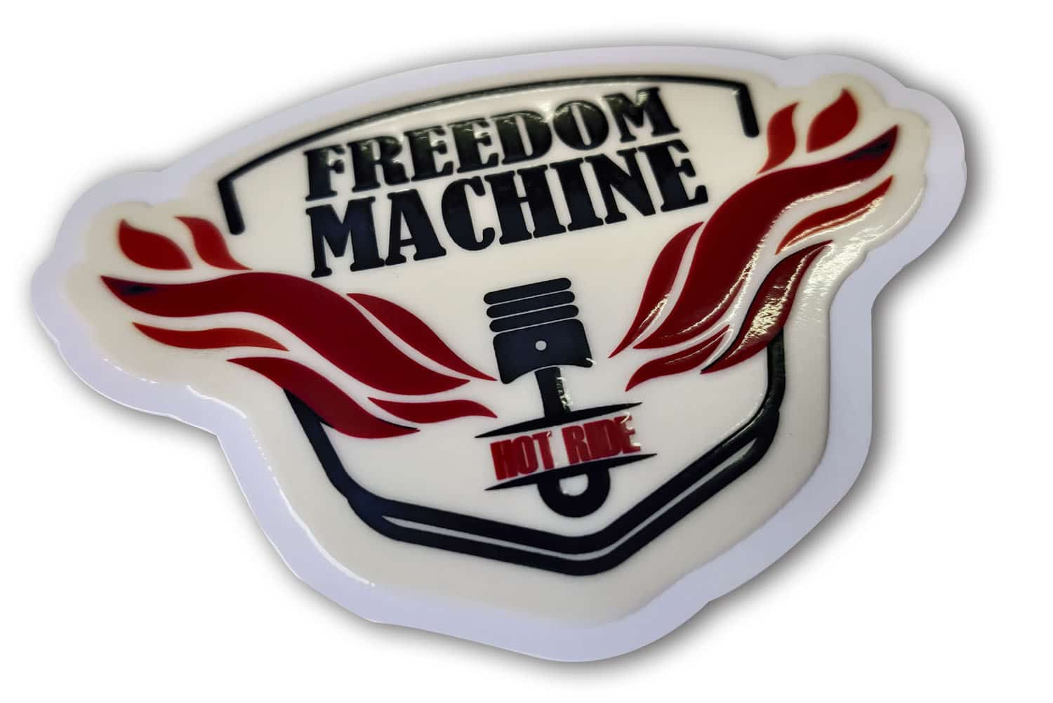 Shape cut sticker of the 'Freedom' brand logo given a raised, embossed effect using a UV ink coat