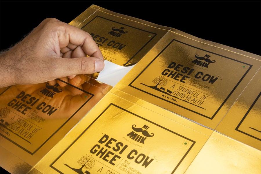 Premium looking stickers printed on a gold finish paper. Attractive metallic labels for Mr. Milk product cartons to draw buyer attention