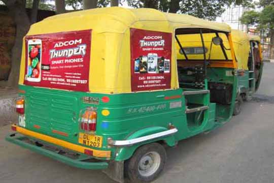 low cost solvent vinyl print pasted on auto rickshaw hoods for short term ad campaigns