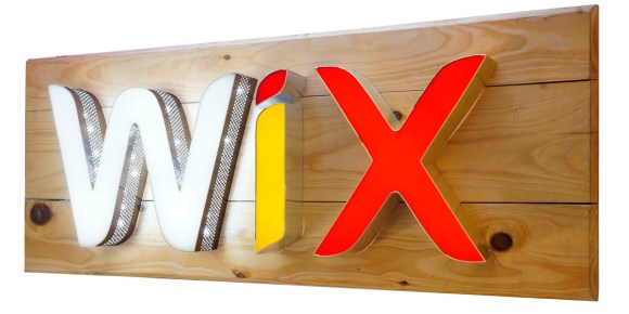 3D letters made with aluminium side channel and acrylic front surface laser cut to create the WIX logo. LED lights embedded inside the letters to glow the same. Perforated channel patti for the letter W with holes on the side