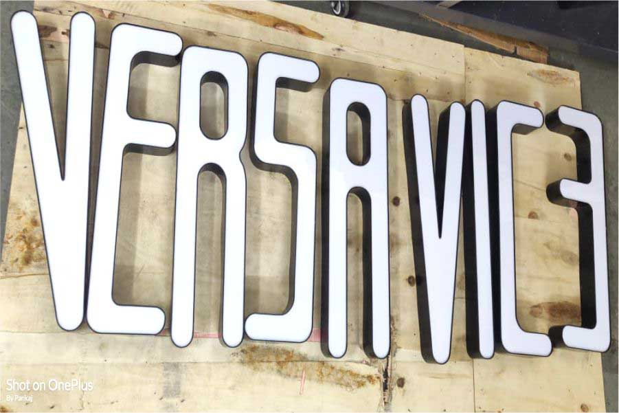 Black channel letters with a white acrylic front surface to create a beautiful sign board for a shop. Letters displayed on a wooden plank spelling out the words Versa Vice