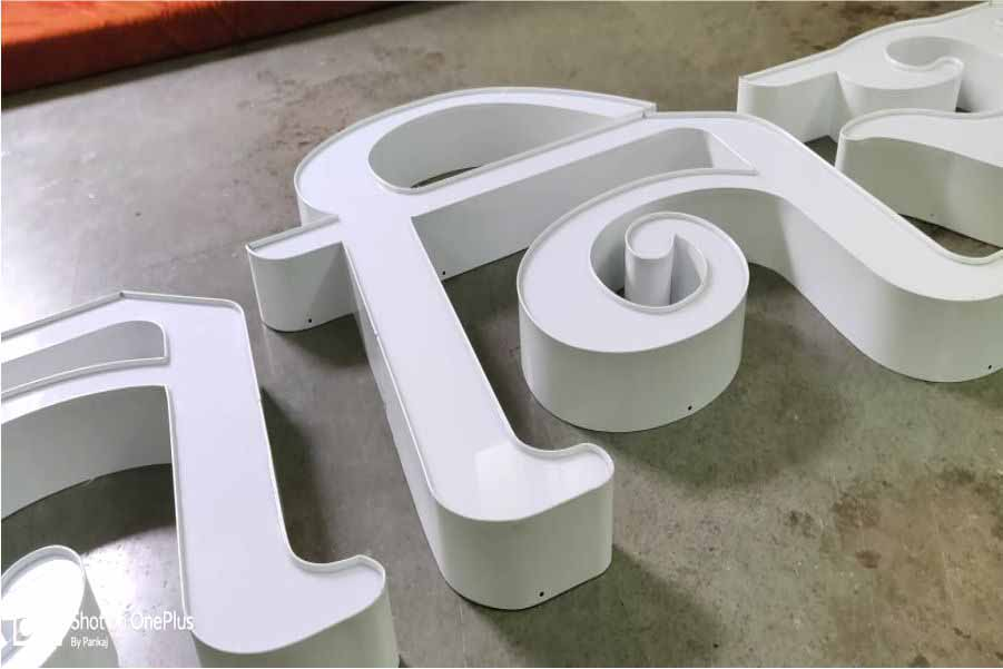 Side view of metallic channel letters fabricated from white aluminum side strip and white acrylic fitted on the top. Channel letters are great for creating beautiful looking LED glow sign boards