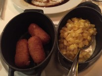 Gruyere cheese tater tots and truffled corn at Chops Grille