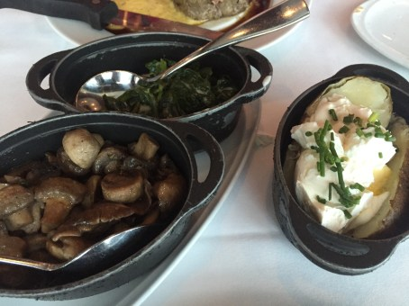 Creamed spinach, roasted mushrooms and salt baked potato at Chops Grille