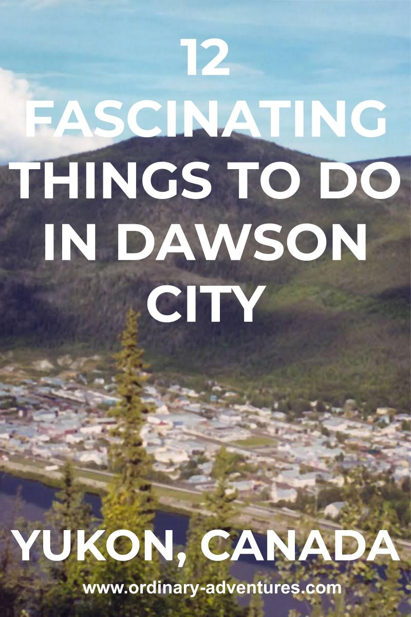 A town seen from above across a river. There are trees in the foreground and a high forested mountain in the background. Text reads 12 fascinating things to do in dawson city yukon, canada