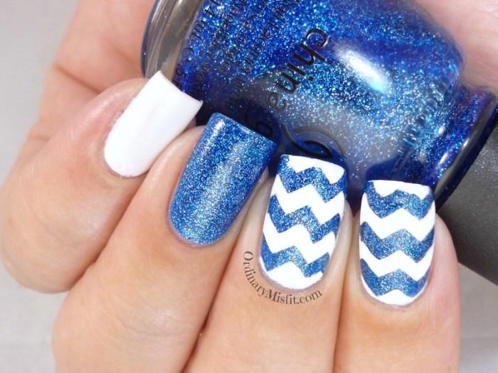 Glittery blue zig zags nail art