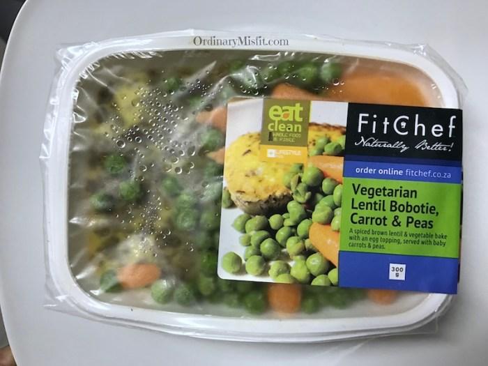 Vegetarian lentil bobotie, carrots and peas