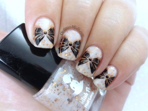 Copper white black bow nail art