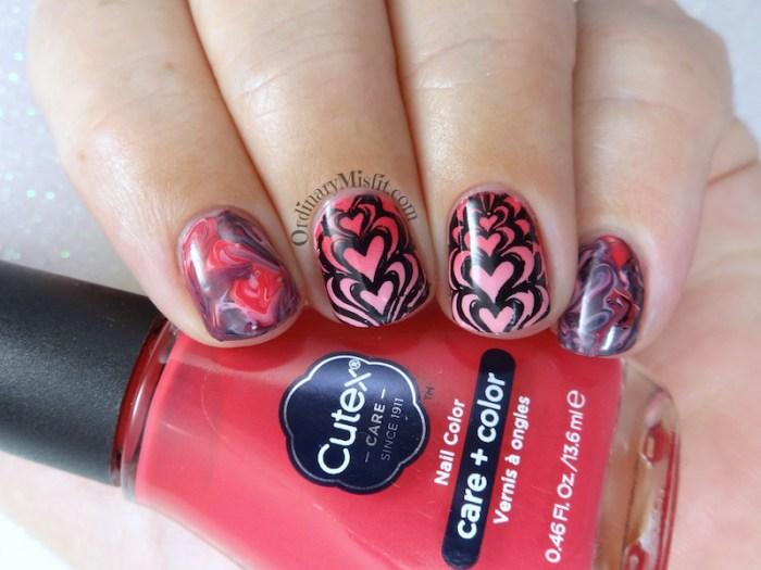 Marbled hearts nail art