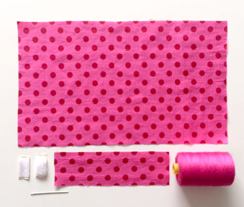 Two squares of cotton fabric, square of Velcro, needle and thread