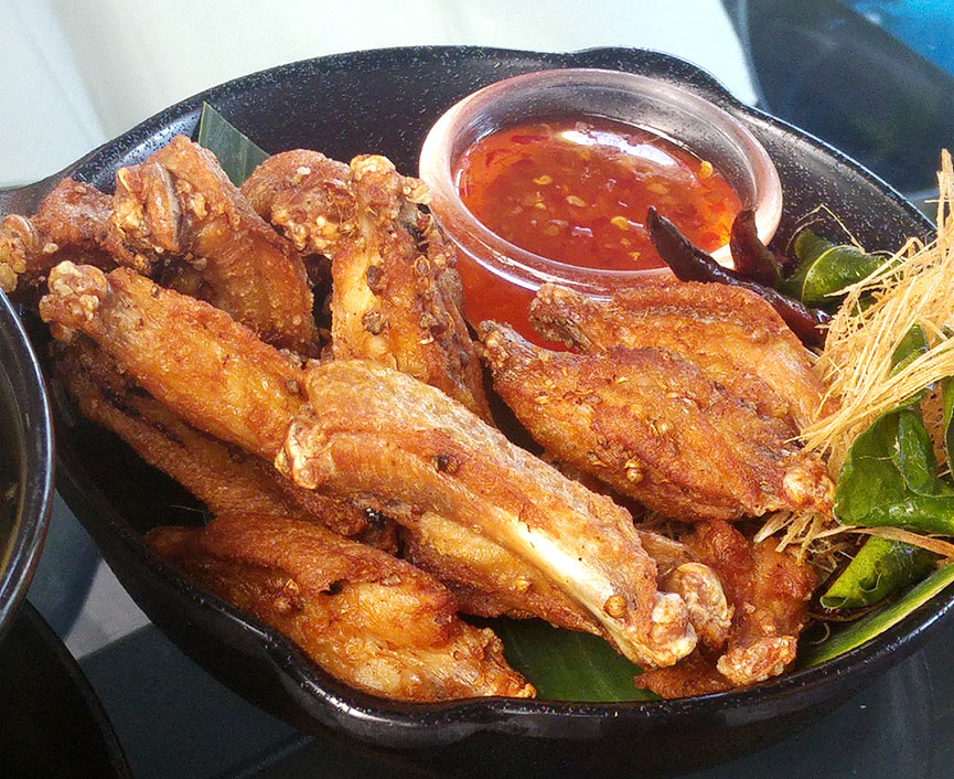 The Neverending Summer crispy chicken wings, sectioned in half for easy eating.