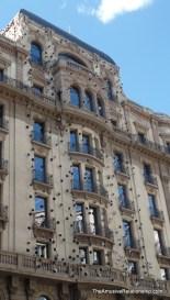 Strange eyes, or surveillance cameras, on the facade of a building