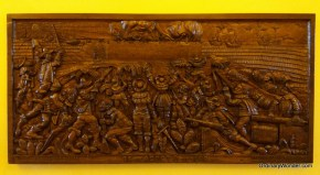 Wood sculpture depicting struggle