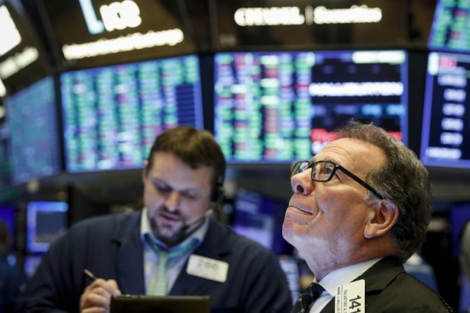 Wall Street opens lower despite new Fed plan
