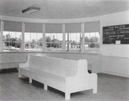 "An interior image was present on file in the Union Pacific Historical Collection! The interior is very modest but very much in the same style. The minimal curved benches served those waiting. A small sign lists ""Portland Rose"" and ""Pacific Limited."""